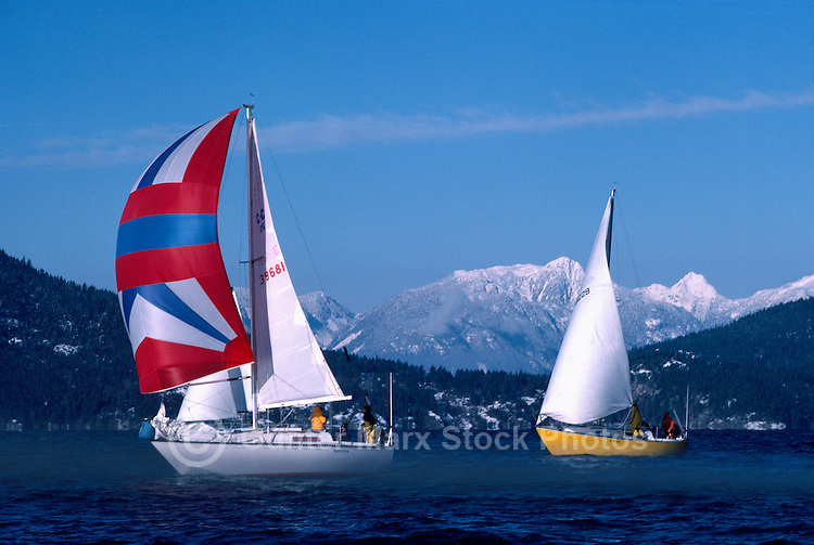 Two Sailboats sailing in Howe Sound near Vancouver, BC, British Columbia, Canada - Coast Mountains, Winter