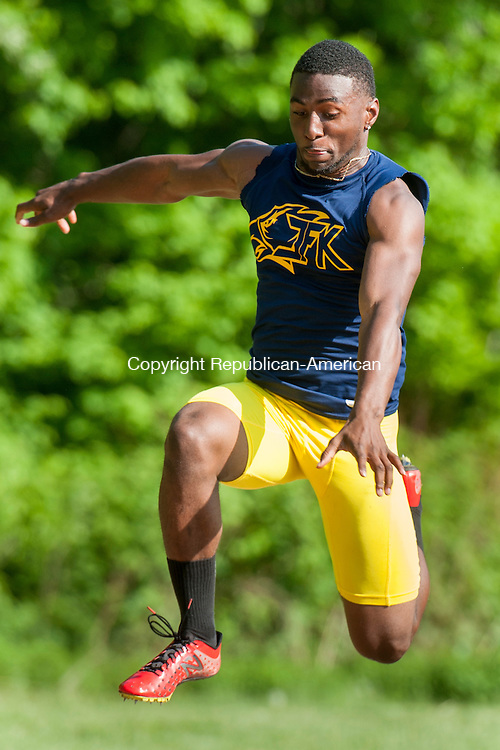 NEWTOWN, CT-19 May 2015-051915EC14-  Kennedy's Eli Benjamin competes in the triple jump at Holy Cross High School Tuesday. Erin Covey Republican-American