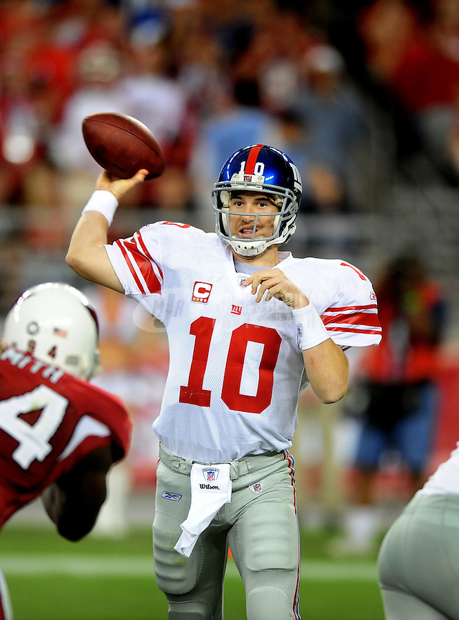 Nov. 23, 2008; Glendale, AZ, USA; New York Giants quarterback (10) Eli Manning against the Arizona Cardinals at University of Phoenix Stadium. New York defeated Arizona 37-29. Mandatory Credit: Mark J. Rebilas-