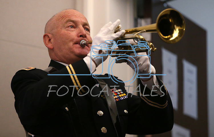 Chief Warrant Officer Albert Pefley with the Nevada National Guard's joint color guard plays &quot;Taps&quot; during the opening ceremony of the Always Lost: A Meditation on War exhibit at the Legislative Building in Carson City, Nev., on Monday, April 6, 2015. <br />