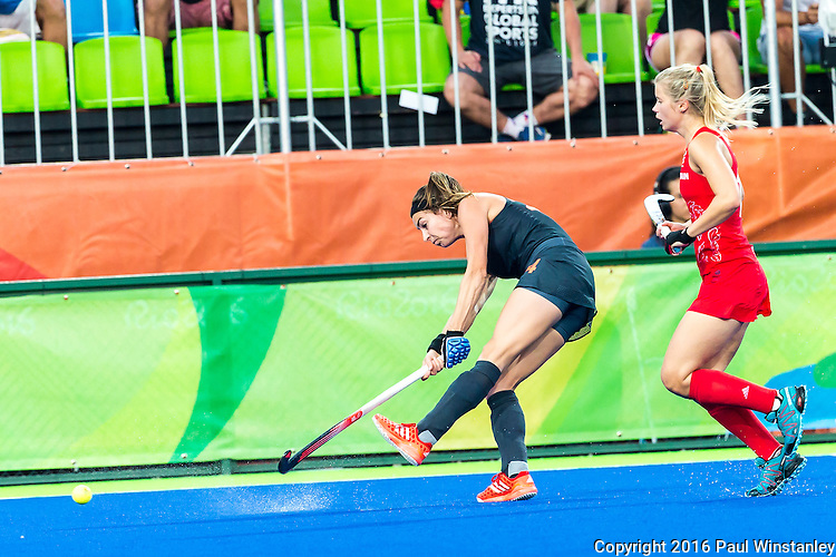 Eva de Goede #24 of Netherlands passes the ball during Netherlands vs Great Britain in the gold medal final at the Rio 2016 Olympics at the Olympic Hockey Centre in Rio de Janeiro, Brazil.