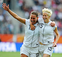 Megan Rapinoe (r) of team USA celebrates with Lauren Cheney during the FIFA Women's World Cup at the FIFA Stadium in Sinsheim, Germany on July 2nd, 2011.