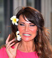 Lizzie Cundy<br /> The &quot;Bula Quo!&quot; UK film premiere, Odeon West End cinema, Leicester Square, London, England.<br /> July 1st, 2013<br /> headshot portrait pink flower in hair mouth open funny teeth hand<br /> CAP/BF<br /> &copy;Bob Fidgeon/Capital Pictures