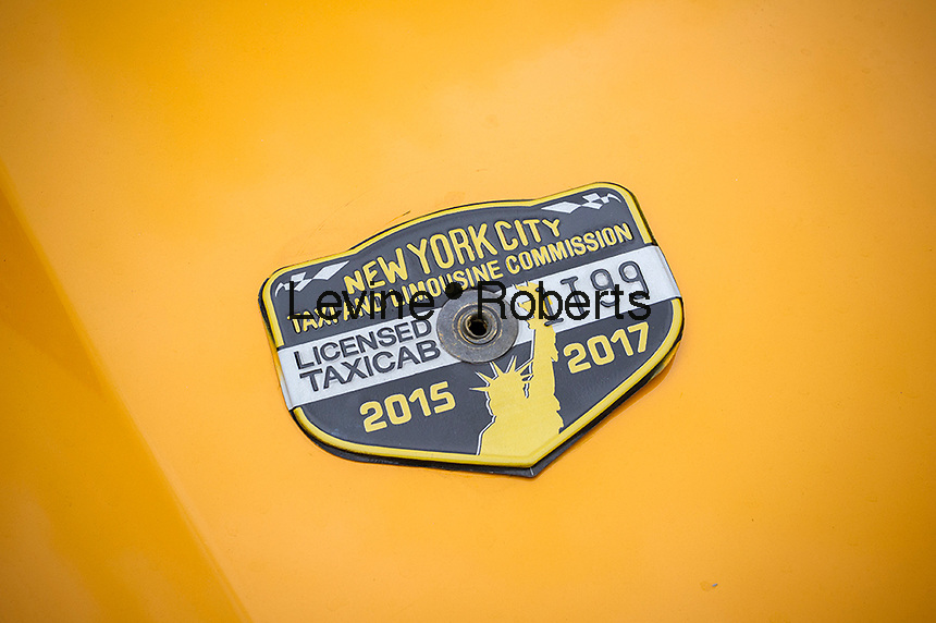A taxi medallion on a cab in New York on Wednesday, April 5, 2017. An NYC taxi medallion recently sold for $241,000, down from a high of $1.3 million just four years ago. Because of the rise in Uber, Lyft and other ride-sharing apps taxi medallions have plummeted with loan delinquencies on the rise.  (© Richard B. Levine)