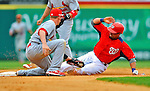 7 March 2012: Washington Nationals outfielder Xavier Paul steals second against the St. Louis Cardinals at Space Coast Stadium in Viera, Florida. The teams battled to a 3-3 tie in Grapefruit League Spring Training action. Mandatory Credit: Ed Wolfstein Photo