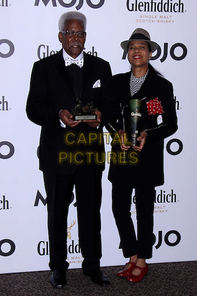 Eddie Floyd & Pauline Black.The Glenfiddich MOJO Honours List award ceremony, the Brewery, Chiswell St., London, England..July 21st, 2011.full suit length black jacket glasses moustache mustache facial hair hat grey gray facial hair award trophy winner .CAP/COA/CC.©CC/COA/Capital .