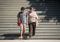 Christian Morales '17 helps his grandmother Veneta Aaron from Texas down the steps between Johnson and Fowler Halls, Homecoming & Family Weekend, Oct. 18, 2013. (Photo by Marc Campos, Occidental College Photographer)