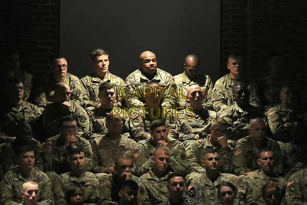 U.S. military personnel listen to President Donald Trump deliver remarks on America?s involvement in Afghanistan at the Fort Myer military base on August 21, 2017 in Arlington, Virginia. Trump was expected to announce a modest increase in troop levels in Afghanistan, the result of a growing concern by the Pentagon over setbacks on the battlefield for the Afghan military against Taliban and al-Qaeda forces.  <br /> CAP/MPI/RS<br /> &copy;RS/MPI/Capital Pictures