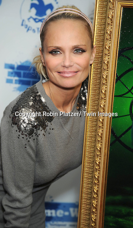 Kristin Chenoweth  at the unveiling of portraits of Sean Hayes and Kristin Chenoweth by Jim Warren, the artist, at Trattoria Dopo.Teatro in New York City on November 21, 2010.