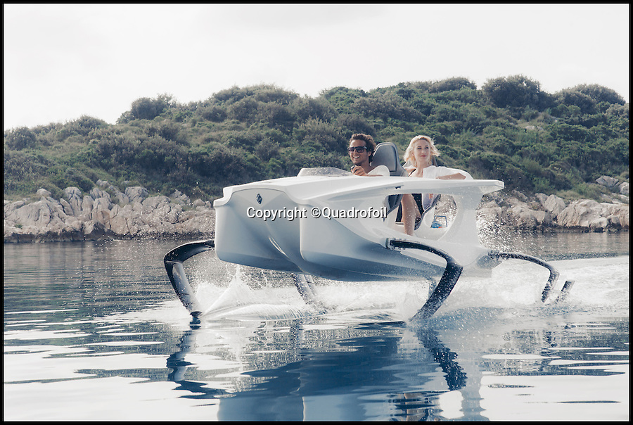 BNPS.co.uk (01202 558833)<br /> Pic: Quadrofoil/BNPS<br /> <br /> ***Please Use Full Byline***<br /> <br /> This cutting edge contraption is being touted as the future of speed boats - because instead of gliding through the water it flies above it.<br /> <br /> The Quadrofoil uses special hydrofoil technology to lift clean out of the water, reducing drag and allowing it to hit speeds of 25mph.<br /> <br /> But because it is powered by an electric motor it costs less than 80p an hour to run - and a new model will set buyers back just £12,000.<br /> <br /> The state-of-the-art boat, called the Quadrofoil, has just been launched by a team of marine engineers from Slovenia.