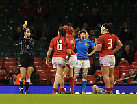 todays referee, Marie Lematte shows the yellow card to Wales Alisha Butchers <br /> <br /> Photographer Ian Cook/CameraSport<br /> <br /> 2018 Women's Six Nations Championships Round 4 - Wales Women v Italy Women - Sunday 11th March 2018 - Principality Stadium - Cardiff<br /> <br /> World Copyright &copy; 2018 CameraSport. All rights reserved. 43 Linden Ave. Countesthorpe. Leicester. England. LE8 5PG - Tel: +44 (0) 116 277 4147 - admin@camerasport.com - www.camerasport.com