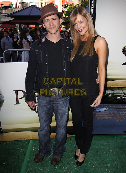 "CLIFTON COLLINS JR. & GUEST.""The Perfect Game"" Los Angeles Premiere held At The Pacific Theaters at the Grove, Los Angeles, California, USA..April 5th, 2010.full length black jacket jeans denim brown hat.CAP/ADM/KB.©Kevan Brooks/AdMedia/Capital Pictures."