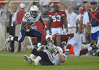 Aug 25, 2007; Glendale, AZ, USA; San Diego Chargers running back Darren Sproles (43)leaps over a teammate and an Arizona Cardinals defender in the first half at University of Phoenix Stadium. Mandatory Credit: Mark J. Rebilas-US PRESSWIRE Copyright © 2007 Mark J. Rebilas