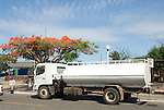 water is delivered by tankers to the cisterns uner the houses in Santa Cruz. The water is pumped up and is not drinkable. The cistern you use for showers and bathrooms.