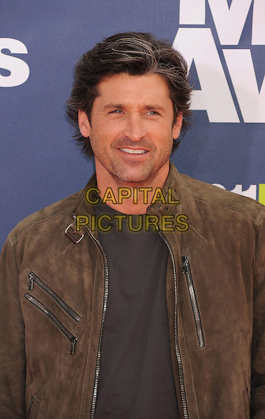 Patrick Dempsey.The 2011 MTV Movie Awards held at Universal Studios Gibson Amphitheatre, Universal City, California, USA..June 5th, 2011.half length grey gray suede jacket blue black top black stubble facial hair headshot portrait .CAP/ROT/TM.©Tony Michaels/Roth Stock/Capital Pictures
