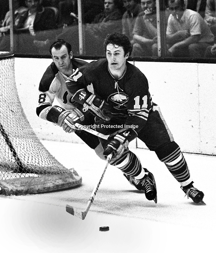 Seals vs Buffalo Sabres 1971..Gerry Ehman chasing Gilbert Perreault..(photo/Ron Riesterer).