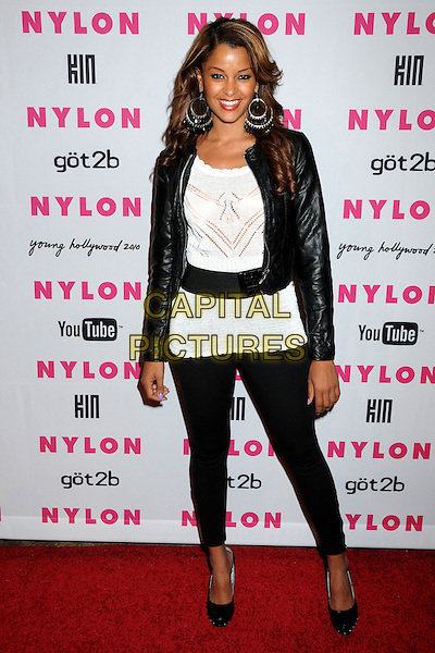 CLAUDIA JORDAN.Nylon Magazine's Young Hollywood Party held at the Roosevelt Hotel's Tropicana Bar, Hollywood, California, USA..May 12th, 2010.full length black leggings white top leather jacket belt crochet .CAP/ADM/BP.©Byron Purvis/AdMedia/Capital Pictures.