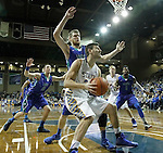 SIOUX FALLS, SD - NOVEMBER 30:  Cody Larson #34 from South Dakota State University looks to the basket in front of Nate Hicks #1 from Florida Gulf Coast in the second half of their game Sunday afternoon at the Sanford Pentagon in Sioux Falls. (Photo by Dave Eggen/inertia)
