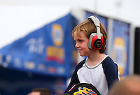 Mar 29, 2014; Las Vegas, NV, USA; A young fan on the shoulders of his dad in the NHRA nitro pits during qualifying for the Summitracing.com Nationals at The Strip at Las Vegas Motor Speedway. Mandatory Credit: Mark J. Rebilas-