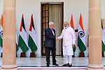 Palestinian President Mahmoud Abbas shakes hands with Indian Prime Minister Narendra Modi before a meeting in New Delhi on May 16, 2107. Palestinian President Mahmoud Abbas is on a four-day state visit to India until May 17. Photo by Thaer Ganaim
