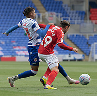 Reading's Michael Olise (left) battles for possession with Middlesbrough's Patrick Roberts (right) <br /> <br /> Photographer David Horton/CameraSport<br /> <br /> The EFL Sky Bet Championship - Reading v Middlesbrough - Tuesday July 14th 2020 - Madejski Stadium - Reading<br /> <br /> World Copyright © 2020 CameraSport. All rights reserved. 43 Linden Ave. Countesthorpe. Leicester. England. LE8 5PG - Tel: +44 (0) 116 277 4147 - admin@camerasport.com - www.camerasport.com