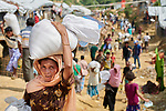 People walk through in the Chakmarkul Refugee Camp near Cox's Bazar, Bangladesh. More than 600,000 Rohingya refugees have fled government-sanctioned violence in Myanmar for safety in this and other camps in Bangladesh.