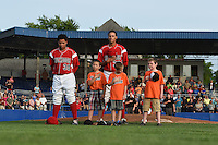 """Batavia Muckdogs first baseman Carlos Duran (30) and pitcher pitcher Gabriel Castellanos (37) stand with the """"Stars of the Game"""" for the national anthem before a game against the Lowell Spinners on July 18, 2014 at Dwyer Stadium in Batavia, New York.  Lowell defeated Batavia 11-2.  (Mike Janes/Four Seam Images)"""