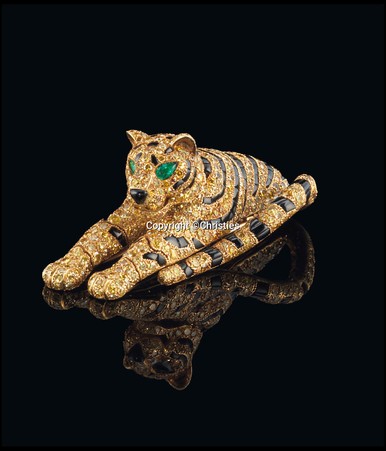 BNPS.co.uk (01202 558833)<br /> Pic: Christies/BNPS<br /> <br /> ***Not For Archive***<br /> <br /> Tiger jewellry burning bright...the brooch.<br /> <br /> Yours for £1.5 million - The tiger jewellry bought by Edward VIII for Wallis Simpson, and then by Andrew Lloyd-Webber for Sarah Brightman.<br /> <br /> Christie's are auctioning a set of stunning tiger jewelry by Cartier that was first owned by the Duchess of Windsor and later given to Sarah Brightman by her former husband, Andrew Lloyd Webber after her triumph in the Phantom of the Opera.<br /> <br /> The two tiger pieces are comprised of an onyx and diamond clip brooch and bracelet, both of which were made in the 1950s and are to be sold as one lot by Christies on November 11th with a presale estimate of a whopping £1.5 million.