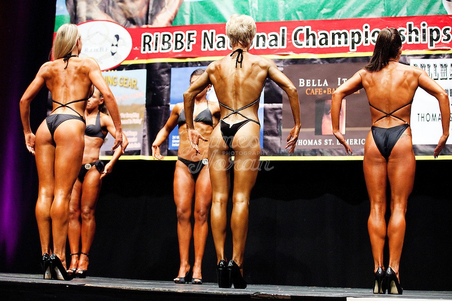 23/10/2010. Irish female physique and figure fitness national championships.  Contestants are pictured onstage during the female physique category as part of the 2010 RIBBF national bodybuilding championships at the University of Limerick Concert Hall, Limerick, Ireland. L-R Ligita Kriksciunaite from Dublin 2nd, Inga Beimore from Dublin 1st and  Katarina Cienka  from Dublin 3rd . Picture James Horan.
