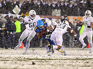 Philadelphia, PA - December 9, 2017:   Navy Midshipmen running back Malcolm Perry (10) gets tackled during the 118th game between Army vs Navy at Lincoln Financial Field in Philadelphia, PA. (Photo by Elliott Brown/Media Images International)
