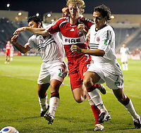 Chicago Fire defender Jim Curtin (5) battles with DC United midfielders Christian Gomez (10) and Matias Donnet (7).  The Chicago Fire defeated the DC United 3-0 in the semifinals of the U.S. Open Cup at Toyota Park in Bridgeview, IL on September 6, 2006...