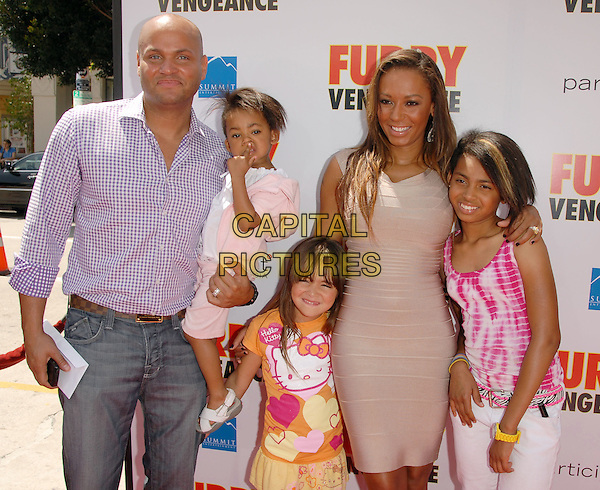 "STEPHEN BELAFONTE, ANGEL IRIS, GUEST, MEL B ( Melanie Brown) & PHOENIX CHI .at the Summit Entertainment L.A. Premiere of ""Furry Vengeance"" held at The Bruin Theatre in Westwood, California, USA, April 18th 2010..half length nude beige body con bandage Herve Leger dress daughters daughter husband wife couple family married purple shirt kids children gingham and white checked check sleeveless tattoo .CAP/RKE/DVS.©DVS/RockinExposures/Capital Pictures."