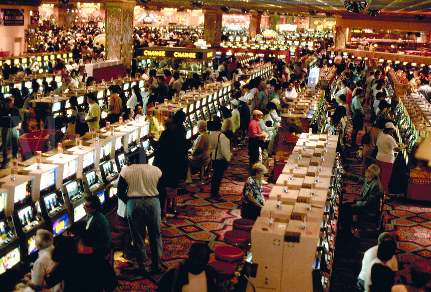 Numerous slot machines in use on the main floor of the Taj Mahal Hotel & Casino, in Atlantic City, New Jersey.  gambling,. Atlantic City New Jersey.
