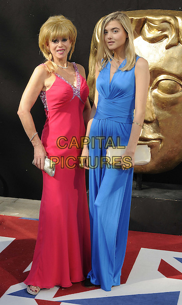 Sally Farmiloe & Jade Farmiloe.Arqiva British Academy Television Awards at the Royal Festival Hall, London, England..May 27th 2012.BAFTA BAFTAS full length blue pink dress clutch bag mother mom mum daughter family .CAP/CAN.©Can Nguyen/Capital Pictures.