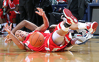 Dec. 07, 2010; Charlottesville, VA, USA;  Radford Highlanders guard Jeremy Robinson (1) battles for a loose ball with Virginia Cavaliers forward Akil Mitchell (25) during the game at the John Paul Jones Arena. Virginia won 54-44. Mandatory Credit: Andrew Shurtleff