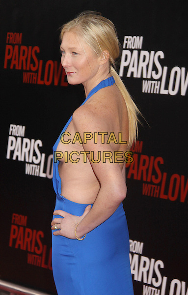 "MAGGIE RIZER .At the ""From Paris with Love"" New York Premiere held at the Ziegfeld Theatre, New York, NY, USA, 28th January 2010..half length blue halterneck dress hand on hip cobalt breast boob profile side braless back rear behind .CAP/ADM/AC.©Alex Cole/Admedia/Capital Pictures"