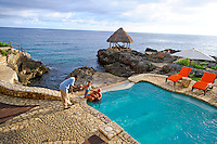 Montego Bay, Jamaica. Couple having drinks at the pool. Jamaica tourism.