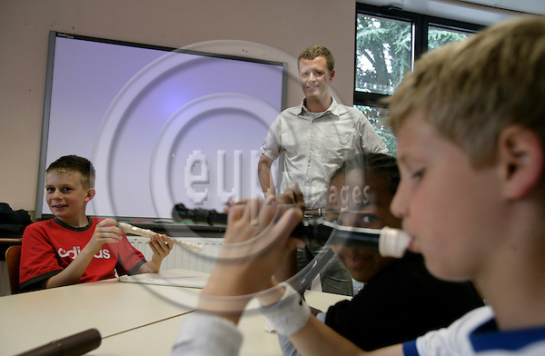 BRUSSELS - BELGIUM - 08 MAY 2007 -- Teacher Claus MEINECHE, from the Danish section of The European School in Uccle, Schola Europaea Bruxellensis I, in his classroom where he gives music lessons. Photo: Erik Luntang/EUP-IMAGES