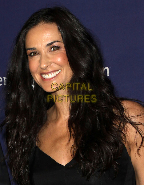 """DEMI MOORE.18th Annual """"A Night at Sardi's"""" Benefitting The Alzheimer's Association held At The Beverly Hilton Hotel, Beverly Hills, California, USA..March 18th, 2010.headshot portrait black smiling.CAP/ADM/KB.©Kevan Brooks/AdMedia/Capital Pictures."""