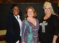 NWA Democrat-Gazette/CARIN SCHOPPMEYER Virginia Germann (center), Dress for Success executive director, with volunteers Dennetta Bradford and Cindy Kaiser welcome supporters to the Little Black Dress wine tasting.