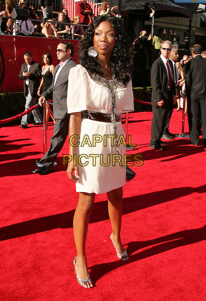 BRANDY NORWOOD.2006 ESPY Awards held at the Kodak Theatre, Hollywood, California, USA. .July 12th, 2006.Photo: Russ Elliot/AdMedia/Capital Pictures.Ref: RE/ADM.full length white dress silver necklace clutch purse belt.www.capitalpictures.com.sales@capitalpictures.com.© Capital Pictures.