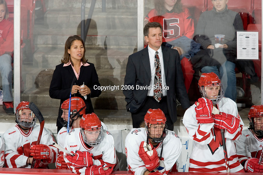 MADISON, WI - SEPTEMBER 29: Assistant coach Tracey Cornell (left) and head coach Mark Johnson of the Wisconsin Badgers women's hockey watch against the Quinnipiac Bobcats at the Kohl Center on September 29, 2006 in Madison, Wisconsin. The Badgers beat the Bobcats 3-0. (Photo by David Stluka)