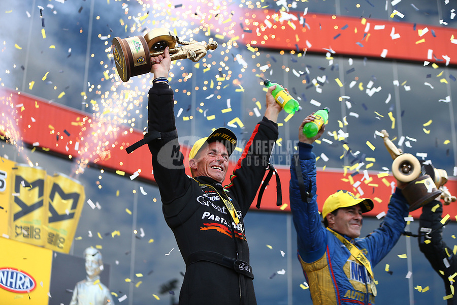 Jun 18, 2017; Bristol, TN, USA; NHRA top fuel driver Clay Millican (left) celebrates alongside funny car driver Ron Capps after winning the Thunder Valley Nationals at Bristol Dragway. Mandatory Credit: Mark J. Rebilas-USA TODAY Sports