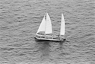 "07 Jul 1972, Newport, Newport County Borough, Wales, UK. French navigator Alain Colas arriving first at the finish line of the Transat Plymouth-Newport race, on his trimaran Pen Duick IV. He will rename the trimaran, which was previously owned by Eric Tabarly, Manureva. Colas would disappear in the Atlantic in November 1978 whilst competing in the first ""Route du Rhum"" race. Image by © JP Laffont"