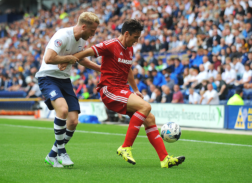 Middlesbrough's Stewart Downing under pressure from Preston North End's Tom Clarke<br /> <br /> Photographer Kevin Barnes/CameraSport<br /> <br /> Football - The Football League Sky Bet Championship - Preston North End v Middlesbrough -  Sunday 9th August 2015 - Deepdale - Preston<br /> <br /> &copy; CameraSport - 43 Linden Ave. Countesthorpe. Leicester. England. LE8 5PG - Tel: +44 (0) 116 277 4147 - admin@camerasport.com - www.camerasport.com