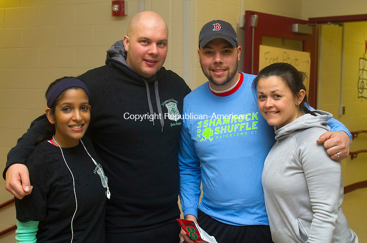 WATERTOWN, CT.- 14 MARCH 2015 - 031415JW02 - Amanda Desai, Frank Rizzo, with John and Kristina Lipeika pose for a photo before the start of the 4th Annual Shamrock Shuffle at Polk School Saturday morning.<br /> Jonathan Wilcox Republican-American