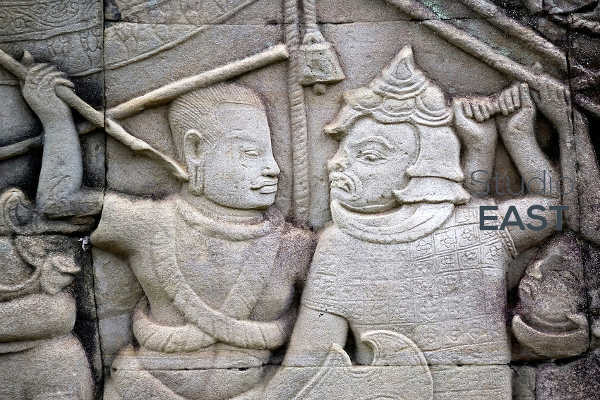 Reliefs depict the battle between Chams and Khmers in 1187, in Bayon temple, in Angkor, Cambodia, on October 3, 2009. The Bayon temple was built in the late 12th century or early 13th century as the official state temple of the Mahayana Buddhist King Jayavarman VII. Angkor used to be the seat of the Khmer empire, which flourished from approximately the ninth century to the thirteenth century. The ruins of Angkor temples are a UNESCO World Heritage Site. Photo by Lucas Schifres/Pictobank.