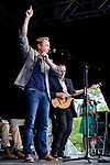 Michael Flatley salutes the crowd after he plays a tune on flute accompanied by his friend Ger Fahey at the official opening of the All-Ireland Fleadh 2017 in Ennis. Photograph by John Kelly.