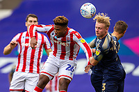 4th July 2020; Bet365 Stadium, Stoke, Staffordshire, England; English Championship Football, Stoke City versus Barnsley; Ben Williams of Barnsley beats Tyrese Campbell of Stoke City to the ball