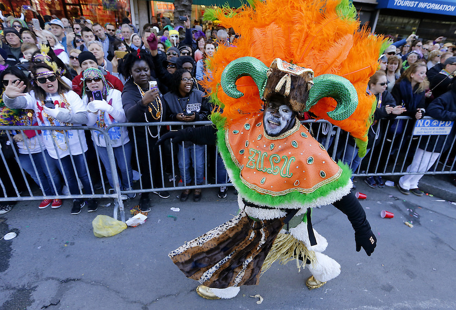 NEW ORLEANS, LOUISIANA - FEBRUARY 9, 2016:  A member of the Zulu Social Aid and Pleasure Club parades down St. Charles Avenue during Mardi Gras day on February 9, 2016 in New Orleans, Louisiana. Fat Tuesday, or Mardi Gras in French, is a celebration traditionally held before the observance of Ash Wednesday and the beginning of the Christian Lenten season. (Photo by Jonathan Bachman/Getty Images)